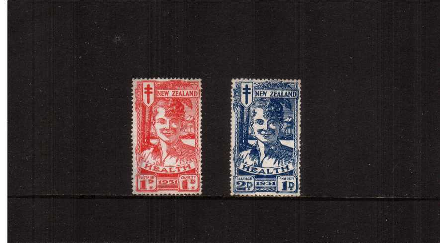 The famous ''Smiling Boys'' set of two fine unused with no gum. Very fresh looking.