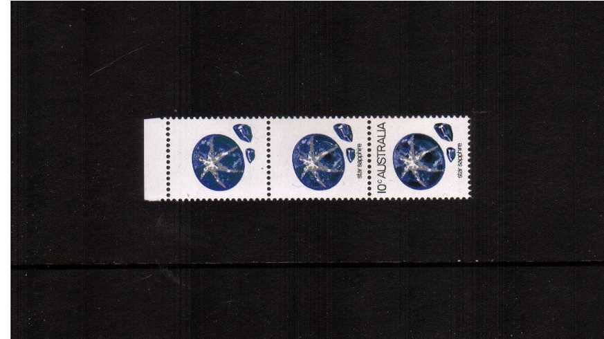 10c Star Sapphire in a top marginal superb unmounted mint vertical strip of three showing ''BLACK OMITTED'' on the marginal stamp and partly omitted on the middle stamp. 